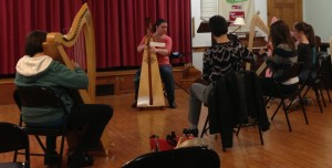 Harper Angela Biggs teaches the beginner harp workshop.